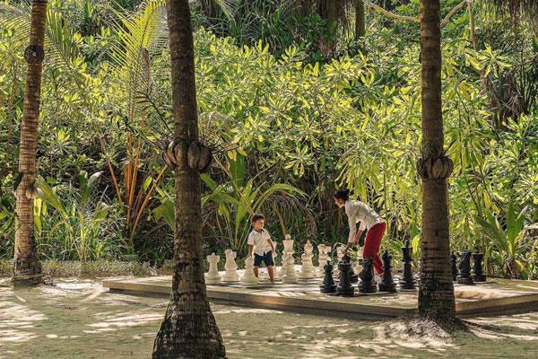 Playing Giant Chess - ©Anantara Kihavah Maldives Villas