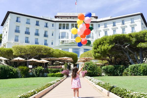 Façade with Balloons - ©Grand-Hôtel du Cap-Ferrat, A Four Seasons Hotel