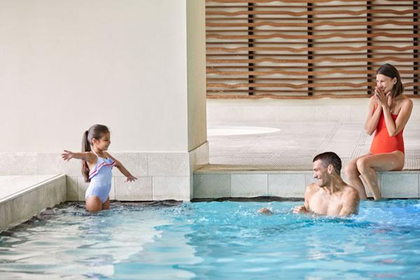 Family in the Indoor Pool - ©The Ritz-Carlton, Toronto