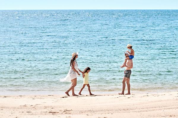 Family Beach Walk ©Four Seasons Resort Nevis, West Indies