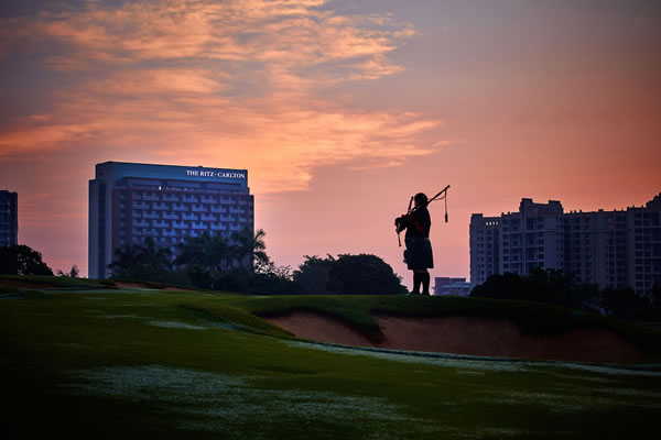 The birthplace of golf, Scotland, is honoured with the sounds of a bagpiper each evening at sunset -©The Ritz-Carlton, Haikou