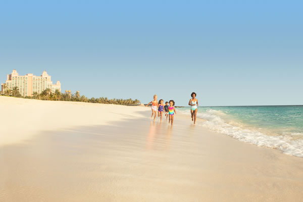 Mom with Kids on the Beach ©Atlantis Paradise Island Bahamas