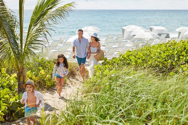 Family Strolling in Beach Dunes ©Four Seasons Resort Palm Beach