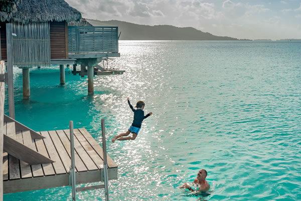 Kid & Dad at Overwater Bungalow ©Four Seasons Resort Bora Bora